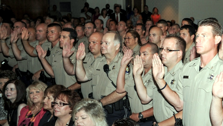 St. Bernard Parish sheriffs deputies take their oath of office. Photo by Errol Schultz.
