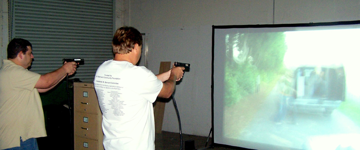 Joel Deutser and Bert Bayhi, members of the 2011 class of the sheriff's Citizens Police Academy lecture sessions, take aim as they use the firearms simulator while watching a computerized scenario that asks them to decide if it would be justified to shoot a criminal suspect. Call 278-7628 to register for free sessions starting Aug. 29 at Nunez College.