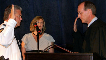 James Pohlmann, with wife, Monique next to him, as sworn in by Louisiana Supreme Court Justice John Weimer.
