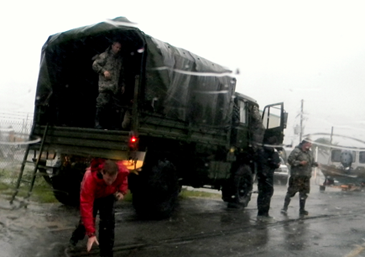 Military trucks prepare to take out Plaquemines Parish residents who were rescued from their homes by St. Bernard sheriff's deputies and others after a breach in the  Caernarvon Canal levee.