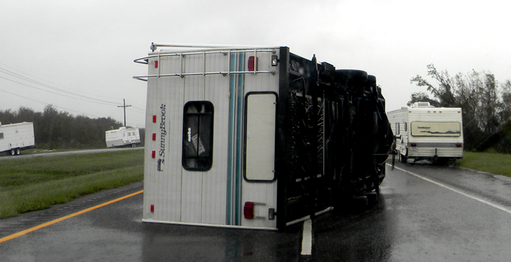 A camper trailer parked inside the hurricane protection levee system at Verret is blown over during the hurricane.