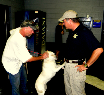 Sheriff James Pohlmann met with people rescued from Plaquemines Parish, shown here talking to Charles Dodds, who brought his dog, Boo Boo.