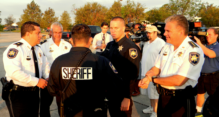 Sheriff James Pohlmann, at right, Maj. Chad Clark, at left, discuss the drug round-up at a staging area. With them are from left, Maj. Mark poche, Cp;. Daniel Bostic and, Narcotics Agent Jason Saltalmachia.