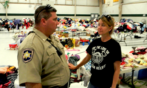 St. Bernard Sheriff's Cpl. Shane Lulei and Suzanne Shaffer, who heads the effort by the Team Braithwaite Foundation to collect and distribute donated goods for victims of Hurricane Isaac flooding, discusses a burglary and theft of $15,000 in goods discovered on Sunday. Behind them are other donated items not stolen.