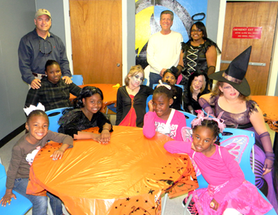 The mentoring group The Girls' Circle had a Halloween party on Saturday, Oct. 27, with guests Sheriff James Pohlmann, standing in back to the left, and Parish President David Peralta, who is standing next to Tiara Howlett, founder of the group. Members of The Girls' Circle, include: seated from left, Rayana Stewart, Zakiya Clark, Taylor Breaud, A'miyah Jones, and back row from left, Anyea Bertrand, Sarah Stanich, Rayana Charles, Ashley Schmiderer and Elena Templet.