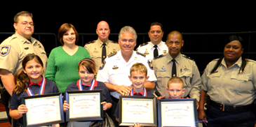 At Gauthier Elementaqry, D.A.R.E. essay winners were, in front, Brooklyn Casanova, Brielle Hoffman, Bryce Fagan, Cameron Vosbein. In back are Sgt. Darrin Miller,Principal Lisa Young, Capt. Ronnie Martin, Sheriff James Pohlmann, Maj. Chad   Clark, Capt. Richard Jackson and Lt. Lisa Jackson.