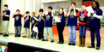 Arabi students stand to sing the D.A.R.E. song in the closing ceremony.