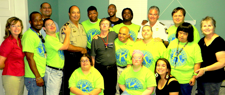Sheriff Pohlmann has visited twice at the Arc Center since it opened in Chalmette more than a year ago. He is shown here with volunteers and the adults who are brought to the center to work on community projects Monday through Friday.