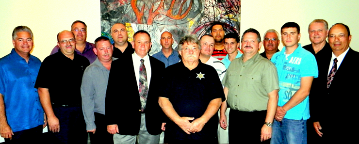 Many of the current members of the St. Bernard Reserve Division are shown at a recent department appreciation dinner with Sheriff James Pohlmann, left, and other rank from the regular force. Included, from left, are the sheriff, Reserve Division Capt. Joe Ricca and Sgt. Mitch Perkins, regular force Capt. Bret Bowen, reserve Deputies Scott Bowles, David Hamburger, Chris Palazzalo, Albert Loar, Lt. Tony Jeansonne, Lathaniel Jackson, Corey Gonzales, Keith St. Germain, regular force Maj. Mark Poche, reserve Dep. Casey Brown, and regular force Chief Deputy Richard Baumy and Capt. Charles Borchers. At the dinner, reserve deputies received gift certificates donated by Cenurion Law Enforcement Supply of Chalmette and Vinson Law enforcement Supply of St. Tammany Parish.