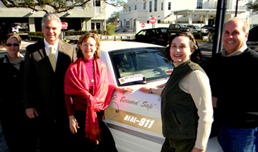 Shown with a vehicle with the new anti-litter message are, from left, Sheriff's Dep. Nicole Miller, Sheriff James Pohlmann, Polly Campbell, executive director of the St. Bernard Community Foundation which donated the stickers; Claudette Reuther, chair lady of the foundation board, and board member Joseph DiFatta.