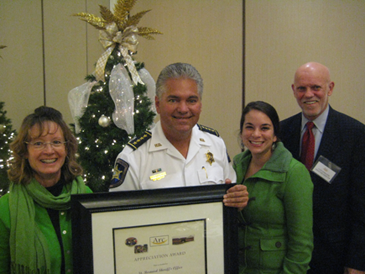 Sheriff James Pohlmann accepts an award from Arc on behalf of the department. Shown with the sheriff are Arc volunteer Polly Campbell, Kristi Andre, who is site director for the Arc Center in Chalmette; and Cliff Doescher, Arc Executive Director. Photo provided by Arc.