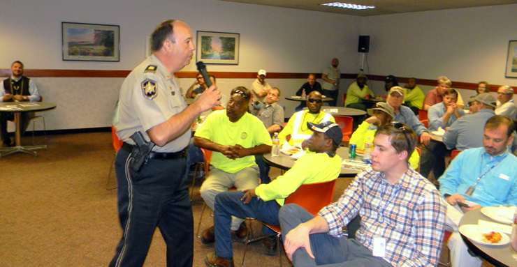 Charles Borchers addresses some of the employees at Jacobs Technology at the Michoud Assembly Facility in eastern New Orleans, where he to spoke about parade safety at their Mardi Gras luncheon.