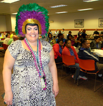 Brie Trocquet, an employee at Jacobs Technology, was festively dressed for the Mardi Gras luncheon,