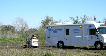 New Orleans police working the investigation of a missing person case used the command center shown to secure a site in eastern St. Bernard until excavation efforts took place Tuesday, which resulted in the finding of a man's body.buried several feet in the ground. The command center was supplied by parish government in cooperation with the St. Bernard Sheriff's Office.