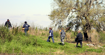 Members of an anthropology team from LSU walk up the ridge in eastern St. Bernard Parish to the site of where they were involved in recovering the body of a man reportedly killed in the city last summer and buried in St. Bernard. NOPD is continuing its investigation, trying to positively identify the victim and his killr.