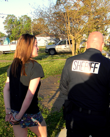 Capt. Ronnie Martin arrests Alexis Eady of Chalmette at her residence.