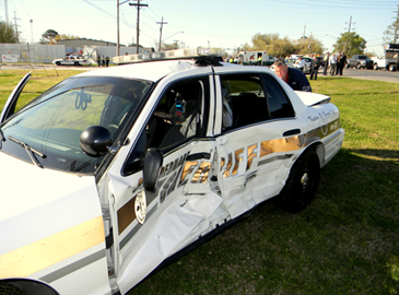Also shown is the sheriff's patrol car the suspect crashed into, with Lt. Mike Ingargiola behind the vehicle.