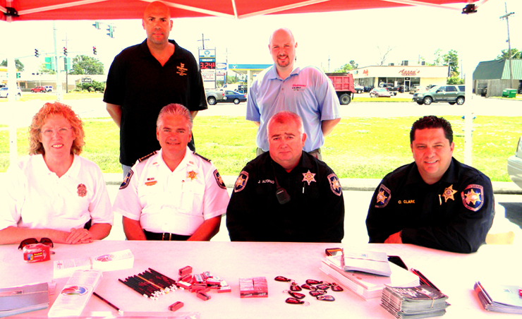 Shown under the tent set up to receive old medications are, front row from left, Lt. Pat Childress, Sheriff James Pohlmann, Sgt. Joey Alfonso and Maj. Chad Clark. In back, from left, are Gerard Robinette, district loss prevention manager for Walgreens and Dustin Mares, community leader for Walgreens stores in St. Bernard Parish and eastern New Orleans.