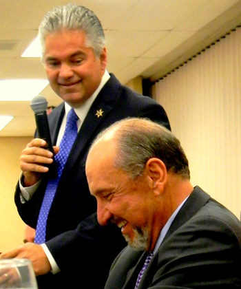 Sheriff James Pohlmann draws a laugh from his former boss.