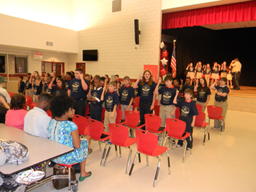 Some of the .D.A.R.E. program graduates at Lacoste Elementary perform the D.A.R.E. theme song.