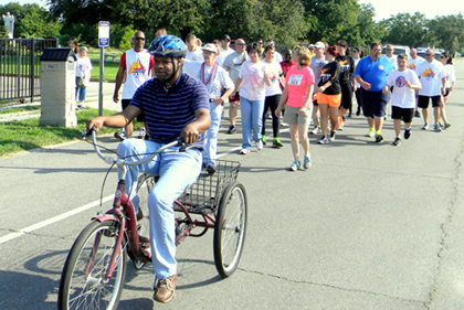 Arc associates used three-wheel bicycles, walked and also ran in the Torch Run.