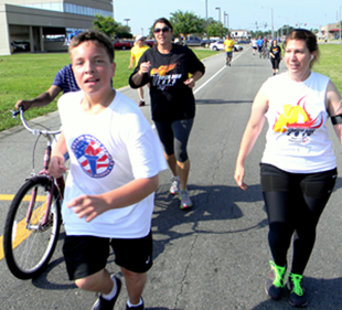 Participants approach the end of the Torch Run, back to the Arc center in Chalmette.