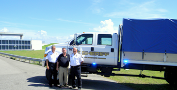 The Sheriff's Office new high-water truck for rescue and moving personnel and equipment, is shown at the Verret floodgate on La. 46 Ext. in eastern St. Bernard Parish. From left are Sheriff James Pohlmann, Capt. Bret Bowen, who heads the equipment division, and Maj. Mark Poche, head of Special Operations.