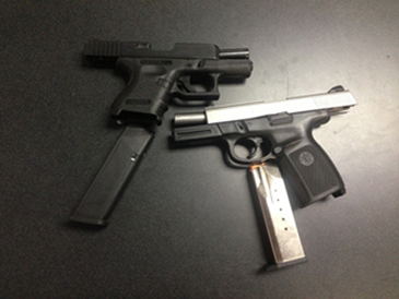 The two semi-automatic handguns recovered in the arrests.