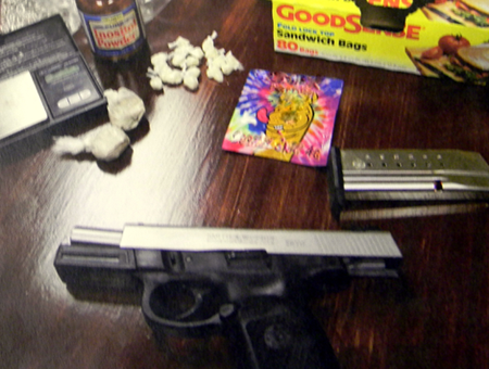 The heroin, crack cocaine, a gun and other items recovered.