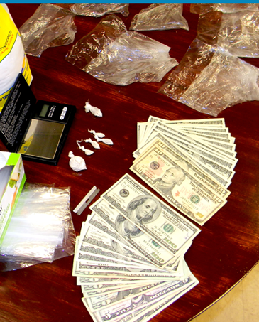 The quarter-ounce of heroin, drug paraphernalia and cash recovered in the arrest.