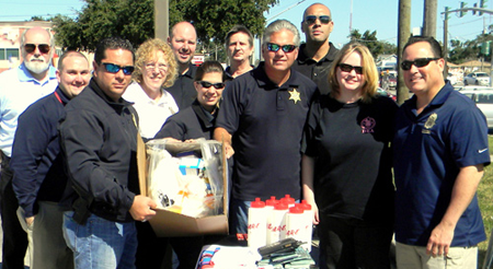 Maj. Chad Clark and Sheriff James Pohlmann hold up one of the boxes containing medications turned in at the Prescription Drug Take-Back Day held Oct. 26 at the Walgreens store in Chalmette. Walgreens officials and law enforcement officers are also shown. On the right in front is Warren Rivera, Assistant Special Agent in Charge of the New Orleans field division for the federal Drug Enforcement Administration, and to his right is his wife, Cheryl Rivera of the FBI. In the middle row, from left, is Chris Lafitte of Walgreens, Capt. Pat Childress and Cpl. Jessica Gernados of the Sheriff's Office. In back, from left, are Walgreens officials Bob Lips, Dustin Mares, James Woringen Jr. and Gerard Robinette.