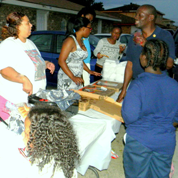 Kevin Gabriel, top right, at a National Night Out Against crime party he hosts in Violet.