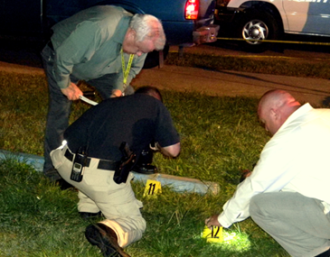 heriff's detectives, from left, Sgt. Steve Guillot, Sgt. Jeff Vega and Sgt. Paul Miller use flashlights to help search for shells at the scene of the murder of a man in Violet Tuesday night in the 3100 block of Daniel Drive.