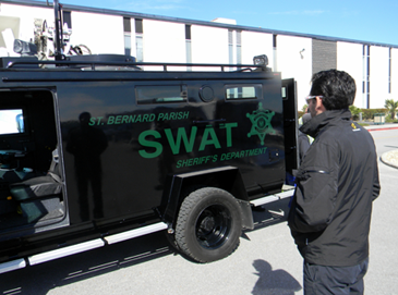 A participant sees his reflection while looking at the SWAT truck.