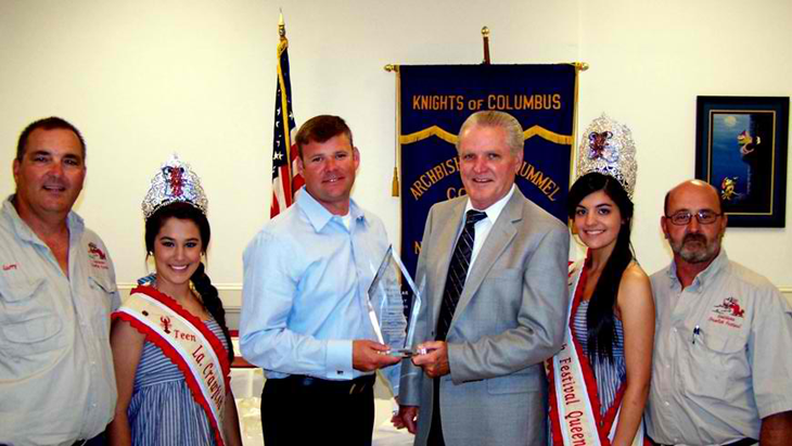 Knights of Columbus Rummel Council St. Bernard Deputy of the Year Lt. Brent Bourgeois, third from left,with Grand Knight Larry Gonzales, Carley Gravois, who is Teen Queen of the Knights of Columbus Louisiana Crawfish Festival for 2011; Sheriff's Office Deputy Chief Richard Baumy, Crawfish Festival Queen Victoria Holmes and Darrel Gonzales, District Deputy.