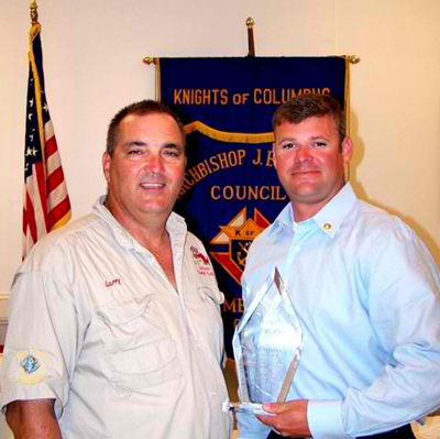 Lt. Brent Bourgeois, right, receives the Knights of Columbus St. Bernard Deputy of the Year Award from Larry Gonzales, left, Grand Knight of the Knights of Columbus Rummel Council 5747 in Chalmette.