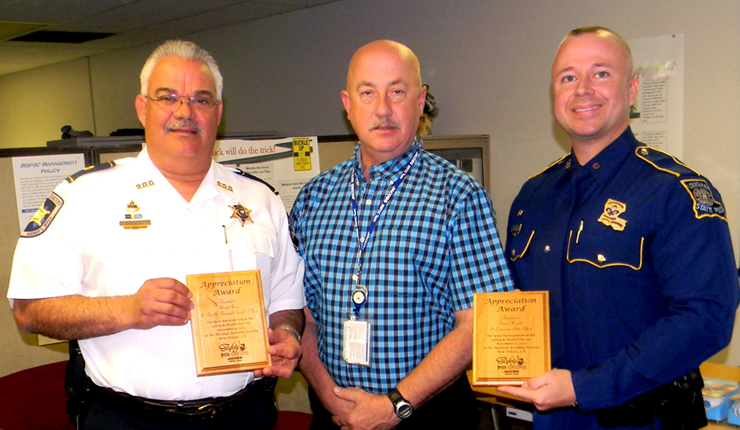 Steve Hanberg of Jacobs Technology, center, presented plaques to Maj. Mark Poche, left. and Trooper Evan Harrell for the Sheriff's Office and State Police's participation in a Nov. 13 Safety and Health Fair at Michoud.