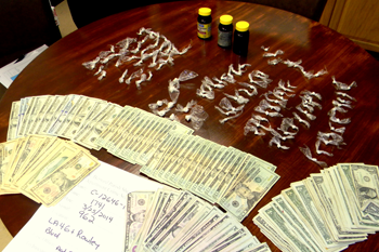 The 1.3 ounces of crack cocaine found mostly in the bottles shown and $3,000 cash seized in the arrests.