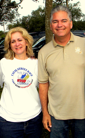 FSheriff James Pohlmann and Darlene Cusanza, CEO of Crimestoppers, shown at a Crimestoppers fundraiser in 2012, are two of the hosts, along with the FBI, of a pool tournament being held as a mixer for law enforcement agencies.