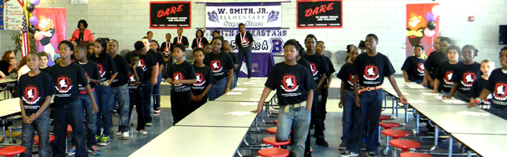 Students at Willie Smith Jr. Elementary perform the D.A.R.E. program theme song for parents.