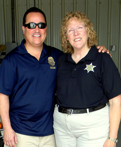 Warren Rivera, Assistant Agent in Charge of the U.S. Drug Enforcement Administration office in New Orleans, is shown with Capt. Pat Childress, adter dropping by the drug take-back event in Chalmette on April 26.
