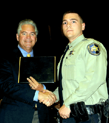 Dep. Richard Chauppetta III receives his certificate from Sheriff Pohlmann.