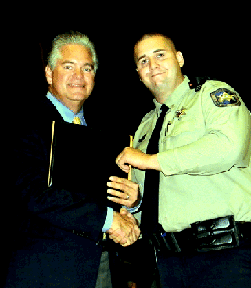 Dep. Kenneth Zulli Jr. receives his certificate from Sheriff Pohlmann.