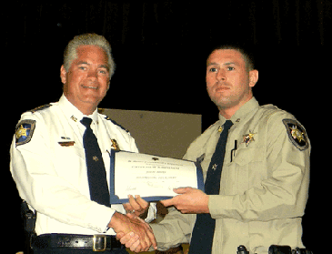 Dep. Joseph Bowen receives his certificate.