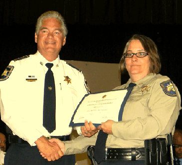 Sgt. Tracy Canino receives her certificate.