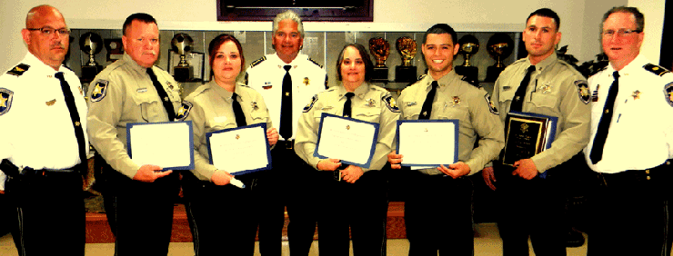 Shown after the P.O.S.T. graduation ceremony are, from left, Col. David Mowers, head of the Corrections Division; graduates Deputies Frank Auderer III and Alisha Casbon; Sheriff James Pohlmann, graduates Sgt. Tracy Canino, Lt. Joshua Correa and Dep. Joseph Bowen and Maj. David DiMaggio, head of training for the Sheriff's Office.