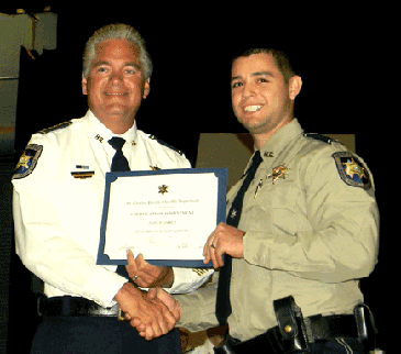 Lt. Joshua Correa receives his graduation certificate from Sheriff Pohlmann.