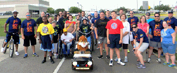 Participants in the Law Enforcement Torch Run for Special Olympics Louisiana, held Friday, May 23 in Chalmette, line up on Jean Lafitte Parkway for the last leg of the run, where St. Bernard sheriff's deputies and agents from Wildlife and Fisheries who began the run at the Parish Courthouse, are joined by a group from the ARC Center, 3710 Jean Lafitte, where local adults with intellectual disabilities receive support. The ARC group walked and rode three-wheel bicycles as the procession ended at their center.