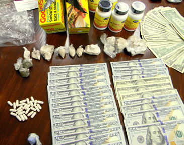 The heroin, pills, synthetic marijuana, Boric acid and some of the $9,422 cash seized.