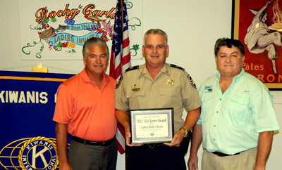 Sheriff James Pohlmann with Life-Saver Award recipient Capt. Walter Dornan and Sam Catalanotto, chairman of the Kiwanis Club Life-Saver Committee.